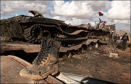 A destroyed tank sits along a road between Benghazi and Ajdabiyah after an air strike by coalition forces.