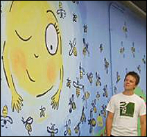 Eric Gustafson admires mural project.