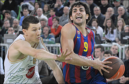 Vlado Ilievski of Union Olimpija challenges Ricky Rubio of Regal Barcelona during their men's Euroleague basketball group B game in Ljubljana in January.