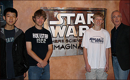 """During a """"Star Wars"""" media preview today, Anthony Daniels (far right) -- C-3PO in the movies -- poses with Joe Kimball's family members (from left, his nephew, Shishen Yu, and sons Alex and Andrew)."""