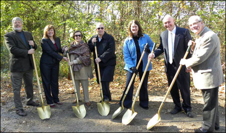 City officials and the St. Paul Parks Conservancy break ground on the group's first project, a Gateway entry for undeveloped Lilydale Park land.
