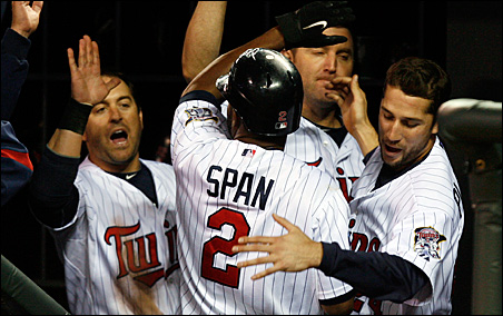 The Twins' eighth-inning rally sealed the deal Tuesday night as Nick Punto, Jim Thome and Trevor Plouffe celebrate with teammate Denard Span, who scored on a hit by Orlando Hudson.
