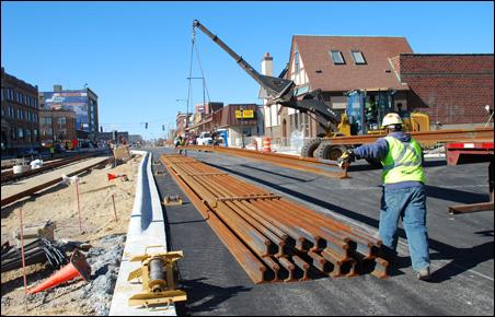 Rail being unloaded on University Avenue near the Raymond Avenue station.
