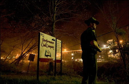 A West Virginia State Police officer stands at the entrance to the Massey's Performance Coal where 12 coal miners were killed in the Upper Big Branch Mine.