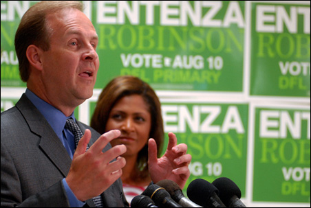 Running mate Robyne Robinson looks on as candidate Matt Entenza concedes Tuesday evening.