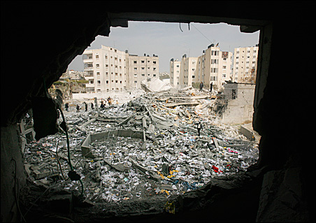 Palestinians inspect the Israeli-bombed Workers Union headquarters in Gaza.