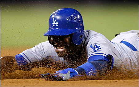 Dodgers second baseman Orlando Hudson slides safe into third base with a sixth inning triple against the San Diego Padres during a game last September.