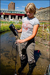 The water in the Outdoor StreamLab is easy to get into and study, as Katie Kramarczuk, seen here with a flow meter, shows.