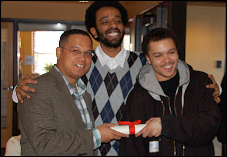 Rep. Keith Ellison, left, met Thursday with students who live at St. Barnabas low-income apartments. The three are displaying a mock copy of a bill Ellison supports to fix a housing rule that hinders the residents' education.
