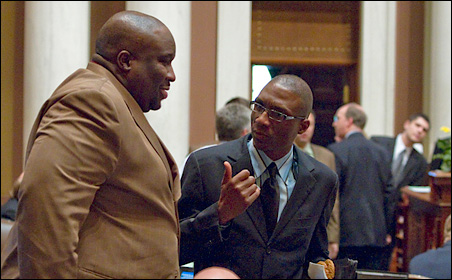 DFL Reps. Jeff Hayden, left, and Bobby Joe Champion, shown on the House floor, have strong feelings about their first legislative session.