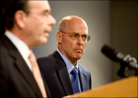 Treasury Secretary Henry Paulson, right, and Jim Lockhart, director of the new Federal Finance Agency, speak during a news conference Sunday.