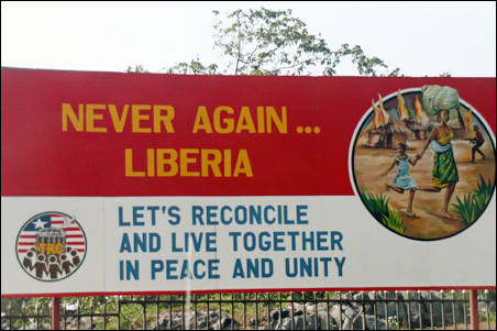A banner in Liberia urging reconciliation.