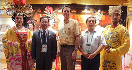 Pawlenty was met at the Shaanxi pavilion by two provincial officials, and then led onto a stage where he posed for photos with performers in traditional costumes.