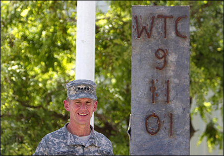 Gen. Stanley McChrystal poses for pictures next to a steel beam from the World Trade Center during a ceremony to commemorate Memorial Day in Bagram airbase, north of Kabul on May 31.