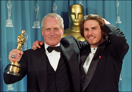 Paul Newman holds the Oscar he received as recipient of the Jean Hersholt Humanitarian Award, presented by Tom Cruise, in 1994.