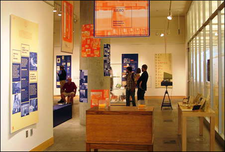 Exhibit visitors in Cargill Hall at the Minneapolis Central Library