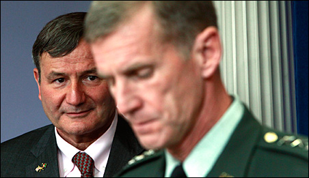 U.S. Ambassador to Afghanistan Karl Eikenberry, left, listens as Gen. McChrystal speaks to reporters on May 10. McChrystal accused Eikenberry of raising doubts about Hamid Karzai only to give himself cover in case U.S. efforts failed.