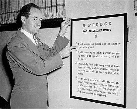 Mayor Hubert Humphrey displays the Pledge for American Unity.
