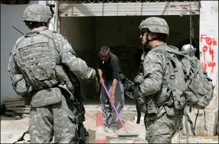 U.S. soldiers inspect the scene of a rocket attack Sunday in Baghdad.