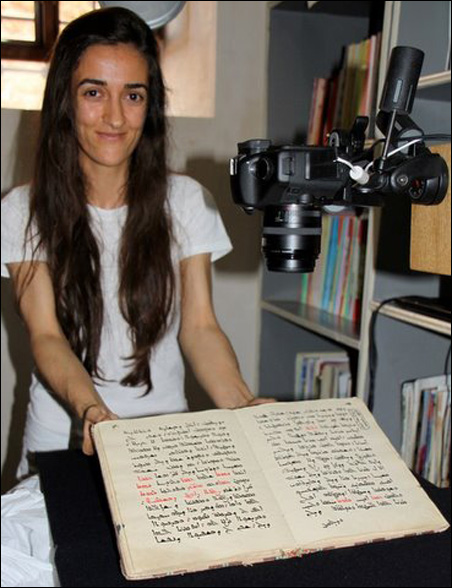 Juliana Gulten shows off a manuscript, one of hundreds that she and her sister have digitalized for HMML at the Monastery of Mor Gabriel.