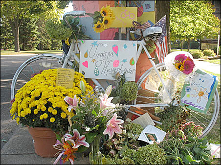"""The """"Ghost Bike"""" is a blossoming memorial to Virginia """"Ginny"""" Heuer at the spot where she was hit."""