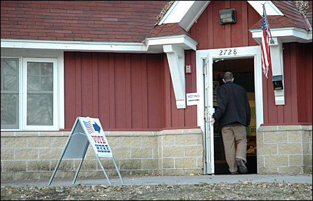 A Minneapolis resident enters the polling place in Brackett Park on Tuesday morning.