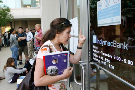 Nurse Lynne Levin-Guzman, who has an account at the failed IndyMac Bank, tries to get someone's attention inside a branch in Pasadena this week.