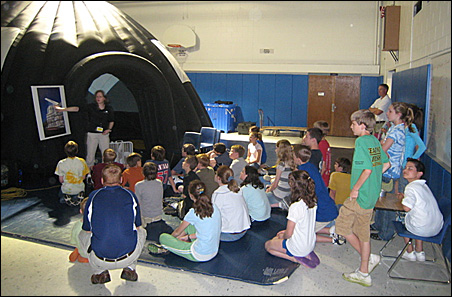 Students prepare to take in a recent appearance by the ExploraDome.