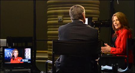 Michele Bachmann talks to FOX News host Sean Hannity after Thursday night's Republican presidential debate in Orlando, Florida.