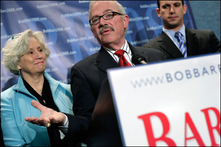 Former Rep. Bob Barr is flanked by his wife, Jeri, and son, Derek, at the National Press Club on Monday.