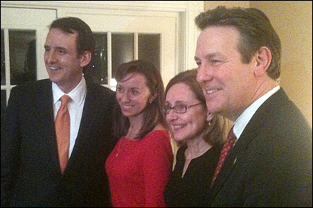 Tim Pawlenty, left, and his wife Mary pose with former New Hampshire senate candidate Ovide Lamontagne, far right, and his wife Betty.
