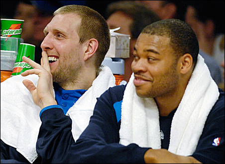 Dallas Mavericks' Dirk Nowitzki, left, and Devean George share a laugh on the bench during a 2007 win over the Los Angeles Lakers.