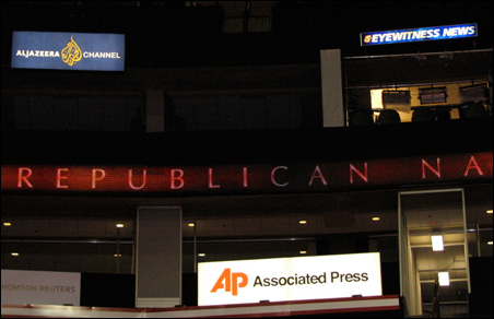Signage and booths for many major news organizations -- including Aljazeera Channel, part of the Arabic-language news network (shown in upper left)  --  ring much of the arena bowl.