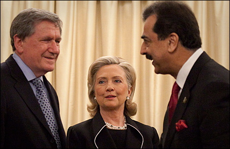 Secretary of State Hillary Clinton, center, watches as Pakistan's Prime Minister Yusuf Raza Gilani, right, greets envoy Richard Holbrooke, left, after arriving at the prime minister's residence in Islamabad on Sunday.