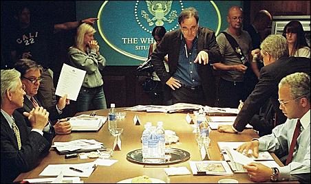 """Oliver Stone, center, on the set of """"W."""""""