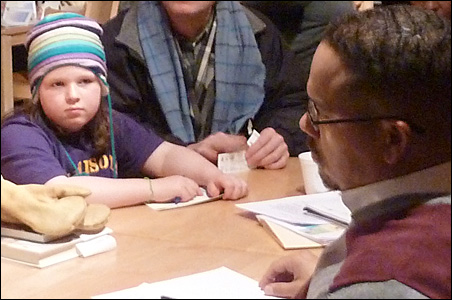 Young Stacia Schirber chatted with Rep. Keith Ellison on Friday.