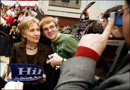 Senator Hillary Clinton (D-NY) poses with a supporter during a campaign event