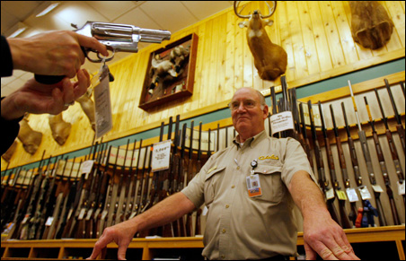 Salesman Larry Allen shows a customer a gun at the Cabela's store in Fort Worth, Texas.