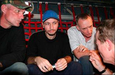 U.S. contractors (left to right) Keith Stansell, Marc Gonsalves and Thomas Howes listen to U.S. ambassador to Colombia William Brownfield after being rescued with Ingrid Betancourt July 2.