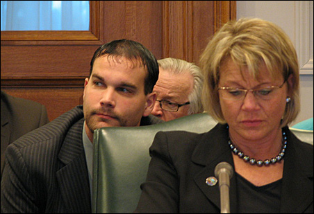 Intern Andrew Archer sitting behind Sen. Lisa Fobbe at a Senate Ag committee hearing.