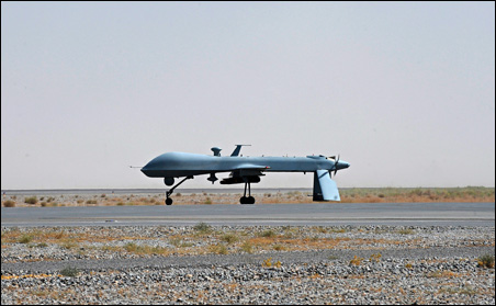 A U.S. Predator unmanned drone armed with a missile stands on the tarmac of Kandahar military airport.
