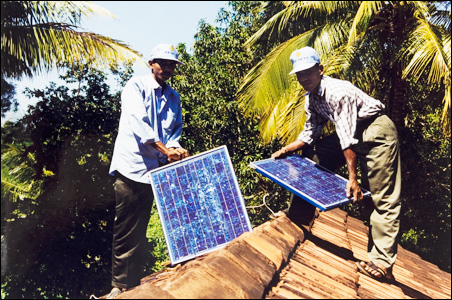 Solar panels are installed on a rural home in Sri Lanka.