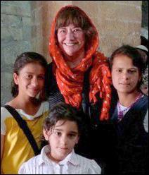 Lyndel King (in orange scarf) with new friends.