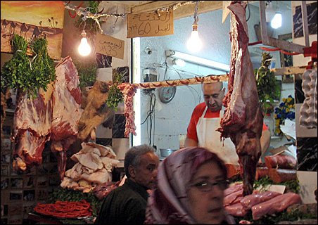 Note the camel's head displayed (just under the light bulb on the left) in this market in Fez.