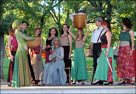 """""""Romeria"""" dancers use small stages in the park."""