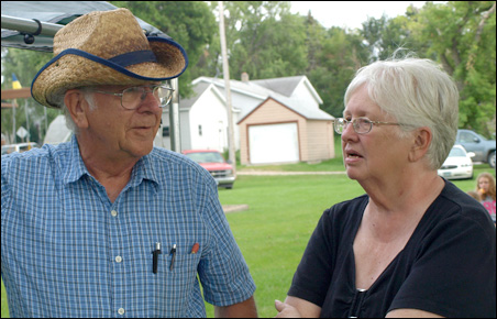 Ed Persons and Muriel Krusemark talked at the farmers market.