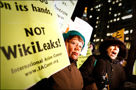 Protestors hold signs and shout in support of WikiLeaks and its founder Julian Assange during a demonstration in front of the Federal building in New York.