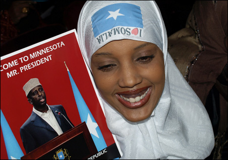 Saadia Ahmed of Bloomington was one of many who wore images of the Somali flag for the president's speech.