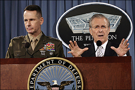 Then-Secretary of Defense Donald Rumsfeld, right, at a news briefing with Gen. Peter Pace, chairman of the Joint Chiefs of Staff at the time, immediately after meeting with retired military men April 18, 2006, to make plans to marginalize war critics.