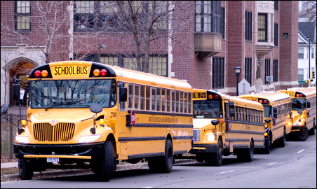 School buses -- long an urban symbol of cross-town integration efforts -- now are busy with other student transportation tasks.